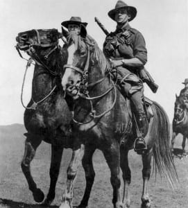 """Australian light horsemen riding waler horses. The soldiers are of the original contingent of the Australian Imperial Force and the photo was taken prior to their departure from Australia in November 1914. The soldier on the right is Trooper William Harry Rankin Woods, 1st Light Horse Regiment, who died of wounds on 15 May 1915, one of the first light horsemen to die during the Battle of Gallipoli."""
